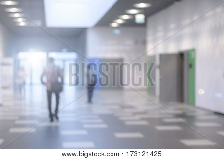 Corridor in a modern business center or a university hall - defocused with bokeh lights