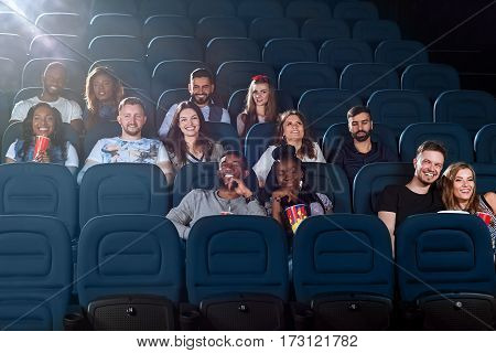 Bomb movie out. Shot of a cinema auditorium full of people watching a movie
