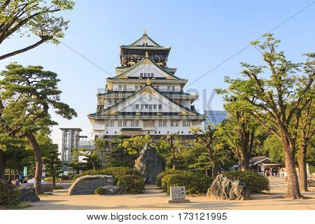 OSAKA JAPAN - AUGUST 1 2015 : The front view of Osaka Castle during summer season this castle is very famous historic tourist attraction of Osaka Japan.