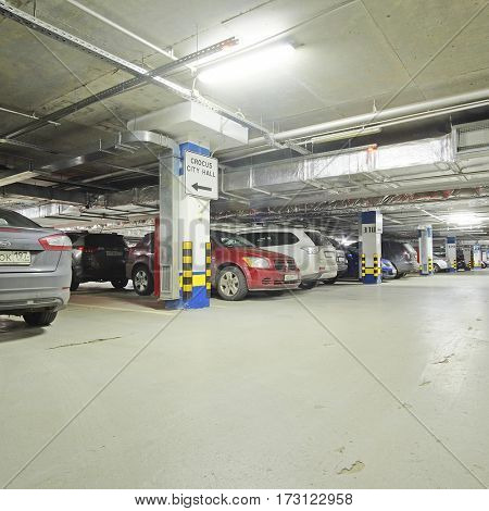 Moscow, Russia - September, 27, 2016: cars on a underroof parking in a Crocus Exhebition center in Moscow, Russia