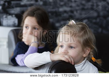 Little girls watching tv