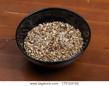 Peeled sunflower seeds in black bowl
