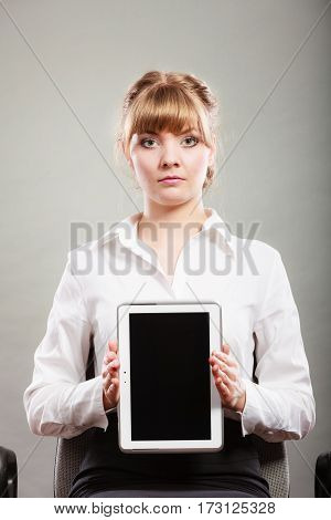 Elegant businesswoman holding blank screen showing copy space. Woman advertising new modern technology.
