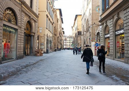 FLORENCE ITALY - FEBRUARY 06 2017: Old medieval street in Firenze