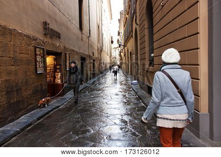 FLORENCE ITALY - FEBRUARY 06 2017: The old medieval street in Firenze after the rain