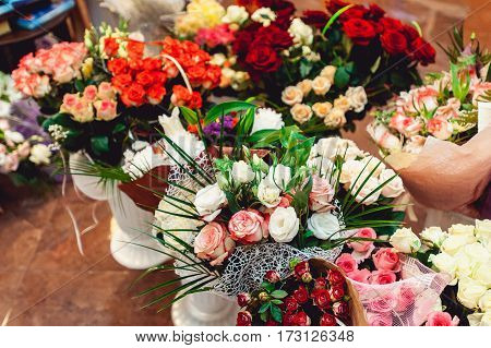 Lot of artificial flowers in colorful composition. wedding gifts