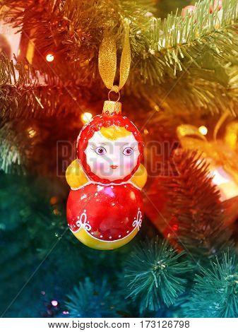 Beautiful Russian toy matryoshka photographed closeup on the Christmas tree