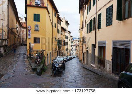 FIRENZE ITALY - February 06 2017 - old street with houses with green shutters bicycles in Florence Italy
