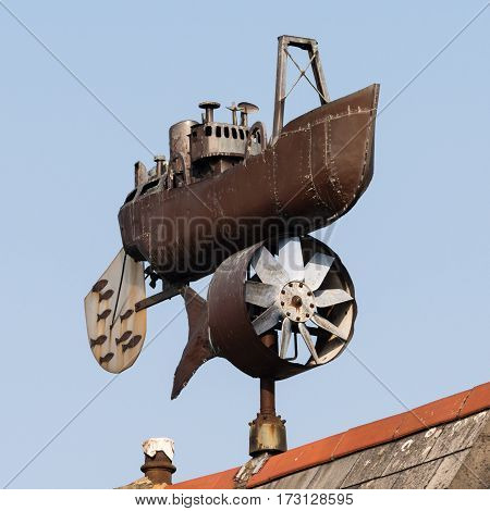 Cardiff Wales UK - February 18 2017: Trawler weathervane by Andrew Hazell. Public artwork created in 1997 on display on roof in Stuart Street on Cardiff Bay