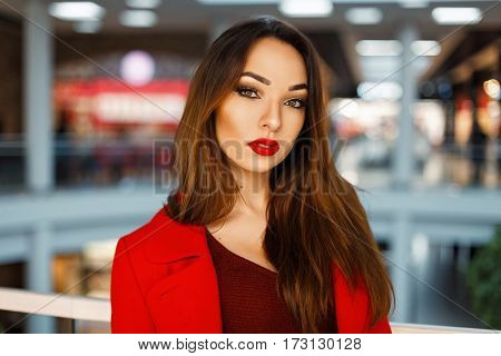 Model Portrait Of A Beautiful Young Girl With Red Lips In A Shopping Mall