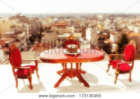 Miniature Classical Dining On A Marble Floor