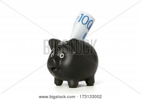 One black piggy bank with one Swedish 100 krona banknote inserted on white background.