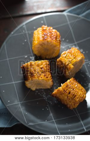 Large pieces of fried corn on ceramic plate vertical