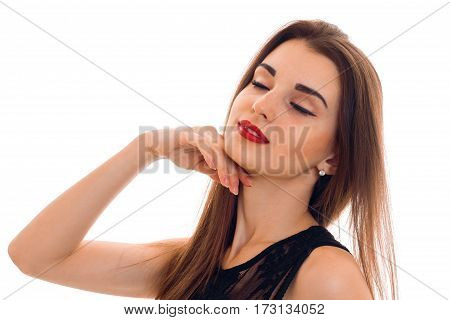 portrait of sensual young brunette woman in stylish black dress posing with closed eyes isolated on white