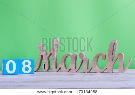 Happy International Women's Day. March 8th. Image of march 8 wooden color calendar on white background. Empty space for text