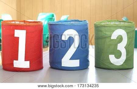 Colorful Cans With One Two And Three Numbers In A School
