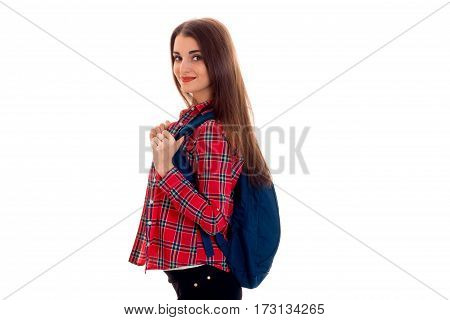 stylish young brunette student girl with blue backpack looking and posing on camera isolated on white