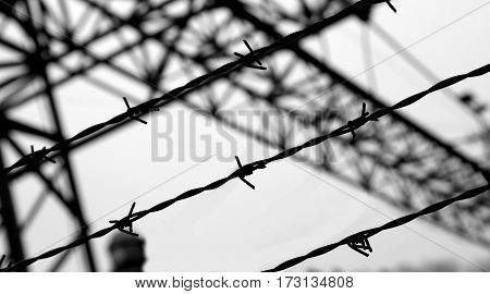 Dramatic Black And White Barbed Wire Fence