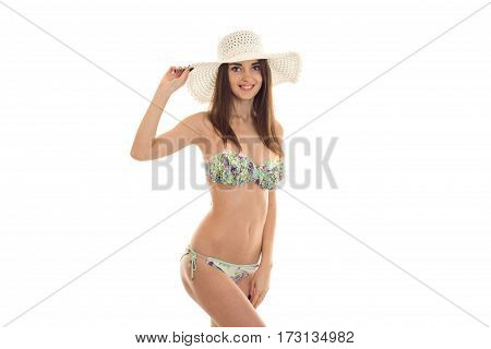 young happy brown hair lady with big natural breasts in swimsuit with floral pattern looking and smiling on camera isolated on white