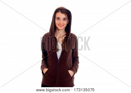 stylish happy brunette student girl in brown sports clothes looking at the camera and smiling isolated on white