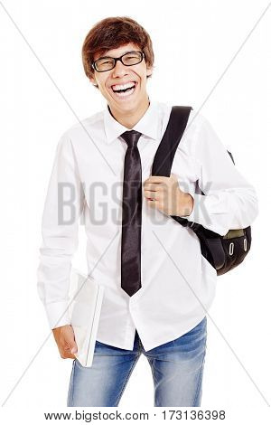 Portrait of young latin man with backpack wearing glasses, blue jeans, white shirt and black tie, holding laptop in his hand and laughing isolated on white background - students and education concept