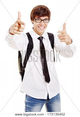 Young hispanic man with backpack wearing glasses, blue jeans, white shirt and black tie showing at camera with his index fingers and smiling perfect healthy toothy smile isolated on white background