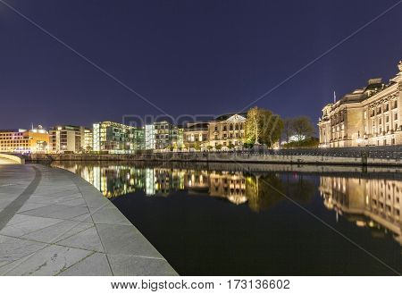 Bundestag Buildings In Berlin Mitte With River Spree By Night