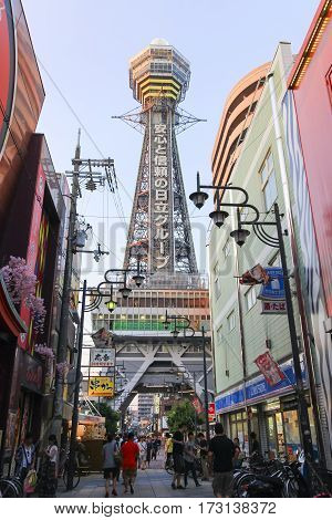 OSAKA JAPAN - AUGUST 1 2015 : Tsutenkaku Tower is a famous landmark and symbol of Osaka city Japan. This tower located in the Shinsekai (new world) district area which many restaurants bars and shops around here.