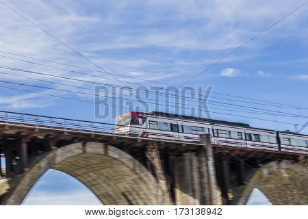 moving train on a bridge where it captures the speed of the train leaving fixed and moving the rest of the photo