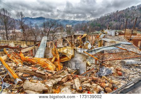 GATLINBURG TN/USA - December 14 2016: A motel complex lies in ruins after a major forest fire roared through Gatlinburg and a large section of the Smoky Mountains in late December 2016.