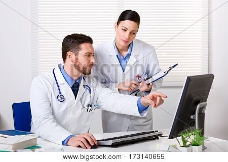 Doctor Showing Something To Colleague