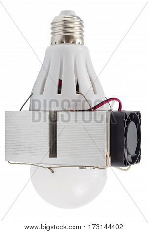 Diy led lamp with huge heatsink and active cooling fan on it. Ugly and messy fast handmade assembly. High power led with half-spherical diffuser used.