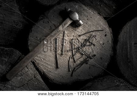 654671 Hammer With Wooden Handle With Many Iron Hobnails On The Wooden Stub. Brutal Male Style