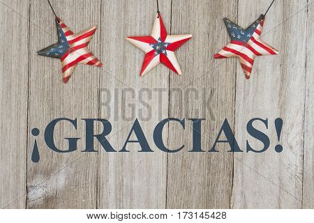 Spanish patriotic thank you message USA patriotic old flag on a stars with weathered wood background with text Gracias
