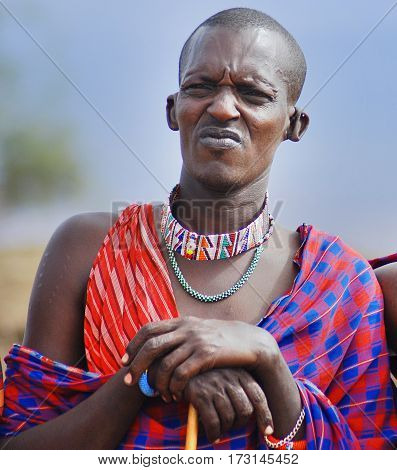 AMBOSELI, KENYA  10 13 11: Portrait of young Maasai man in Masai Mara, Kenya. Maasai (Masai) are a Nilotic ethnic group of semi-nomadic people located in Kenya and northern Tanzania