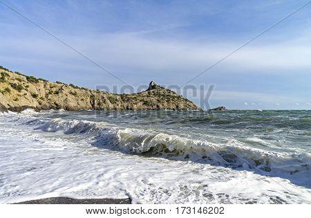 Strong surf on a sandy beach. The small bay on the Black Sea. Crimea September.