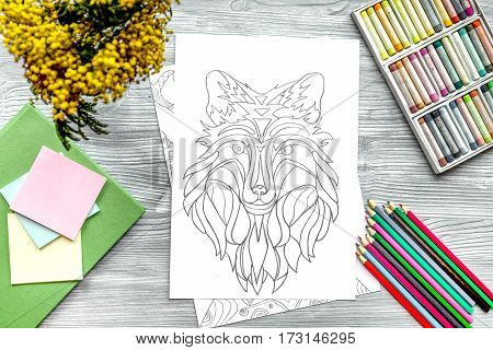 coloring picture for adults on wooden background top view.