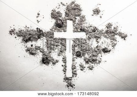 Ash wednesday cross crucifix made of ash dust as christian religion Jesus god faith holy holiday concept background