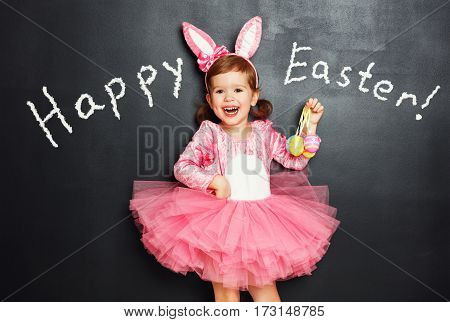 Happy easter! Child girl with bunny ears and eggs.