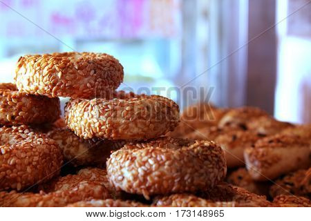 Round small bagels covered with sesame seeds