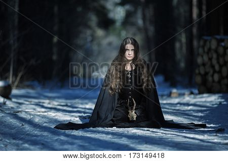 The witch with a skull in the forest