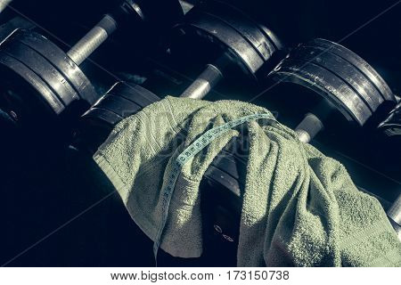 dumbbells barbell with towel at gym for healthy training sport weight lifting to workout