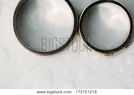 Close up of wedding ring on wooden table. top view.