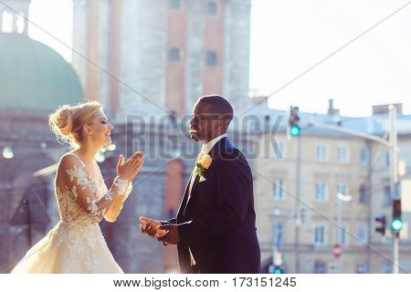 Happy African American Groom And Cute Bride Laughing On Street