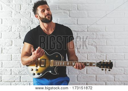 Male Playing The Guitar