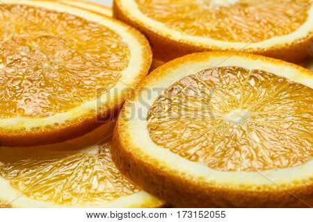 Fresh cut orange fruit background, many pieces of oranges, macro close up photo of healthy food