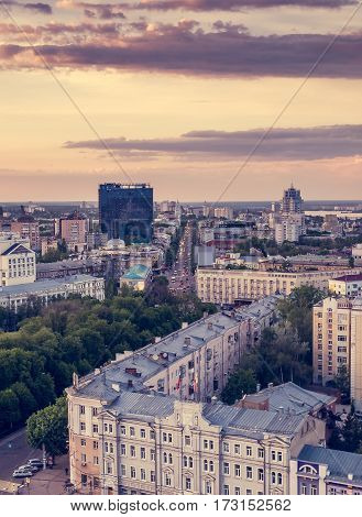 Voronezh, evening summer cityscape, colourful sky at sunset light, vertical image