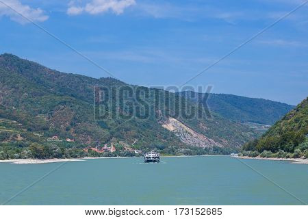 WACHAU VALLEY AUSTRIA - 28TH AUGUST 2015: Boats along the River Danube in the Wachau Valley. Hills and wineries and people can be seen.