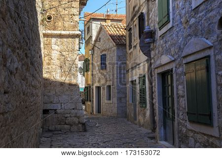VODIVE, CROATIA - SEPTEMBER 6, 2016: This is one of the alleys of the old historic part of the small Croatian seaside town.