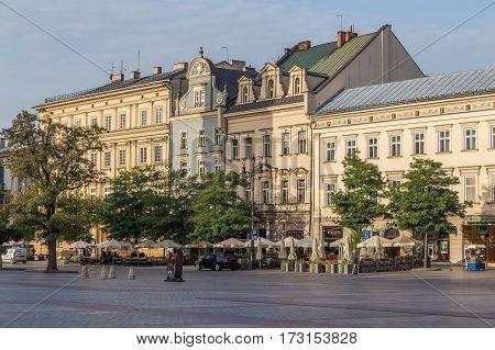 KRAKOW POLAND - 15TH OCTOBER 2016: Buildings along the outside of Rynek Glowny. Restaurants can be seen.
